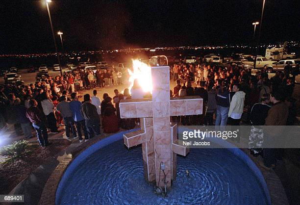 Church members circle a bonfire of Harry Potter and other books outside the Christ Community Church December 30 2001 in Alamogordo New Mexico The...