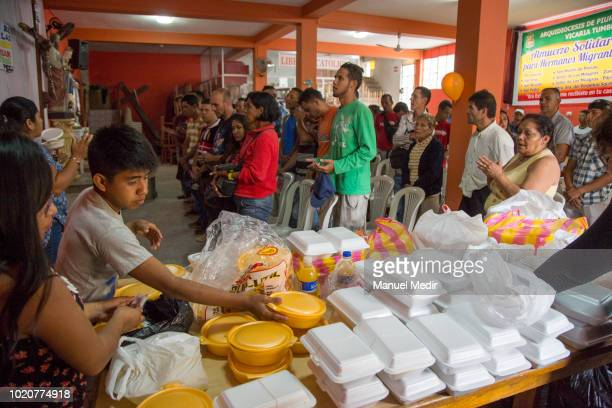 Church members praying for Venezuelan people before delivering food at the church of San Nicolás on August 17 2018 in Tumbes Peru According to...