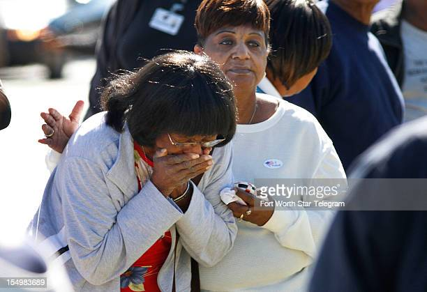 Church members reacted as they arrived at the Greater Sweethome Missionary Baptist Church in Forest Hills Texas where the pastor was killed when a...