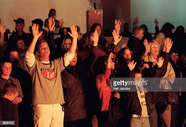 Church members sing as they circle a bonfire burning Harry Potter books outside the Christ Community Church December 30 2001 in Alamogordo New Mexico...