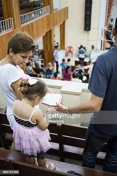 Church members stand during service at the Evangelical Pentecostal Assembly of God Church in Havana Cuba on Friday Sept 18 2015 Cuba which hosts a...