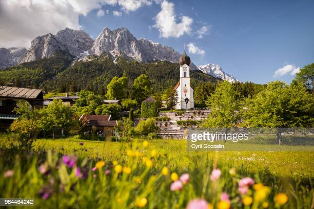 church of grainau and zugspitz-massif - upper bavaria stock photos and pictures