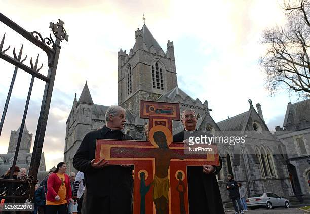 Church of Ireland Archbishop Michael Jackson joins Catholic Archbishop Diarmuid Martin to carry a cross from Christ Church Cathedral to St Mary's...