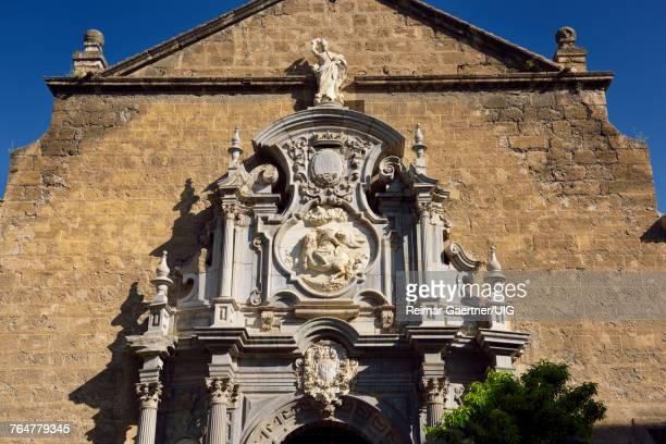 church of saint justus and pastor with statue of saint ignatius n the university plaza granada - universidad stock pictures, royalty-free photos & images
