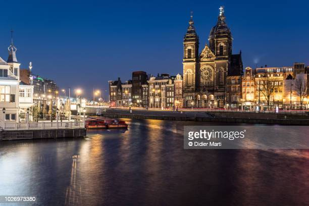Church of Saint Nicholas during blue hour in the heart of Amsterdam old town in the Netherlands capital city