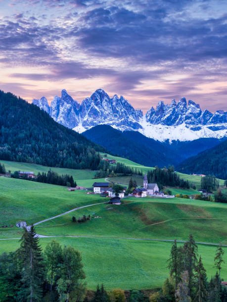Church of Santa Maddalena at Funes Valley with the mountains of Geisler Gruppe in the background, Dolomites, Trentino-Alto Adige, Italy