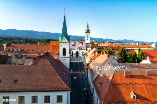 church of st. mark timelapse and parliament building zagreb, croatia. top view from kula lotrscak tower - zagreb stock-fotos und bilder
