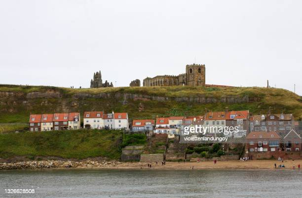 church of st mary graveyard & whitby abbey - cliff stock pictures, royalty-free photos & images