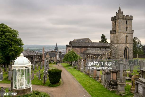 Church of the Holy Rude with Bell tower and Royal Cemetery with historic gravestones and memorials on Castle Hill above Stirling Scotland UK