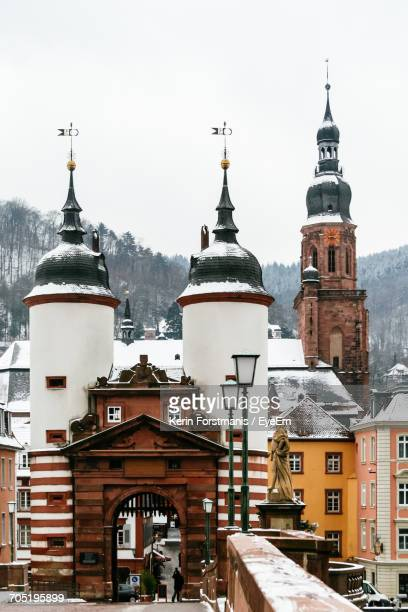 church of the holy spirit bell tower seen from bridge during winter - heidelberg germany stock pictures, royalty-free photos & images
