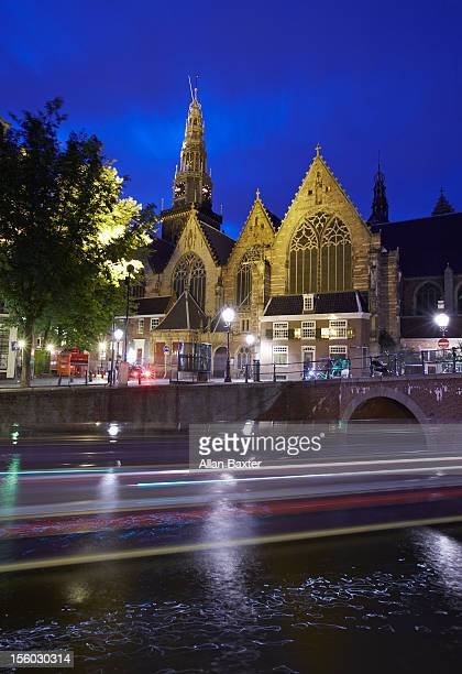 Church of Westerkerk and canal at night