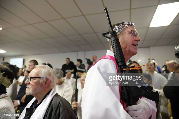 A church offical holds an AR15 rifle during a ceremony at the World Peace and Unification Sanctuary in Newfoundland Pennsylvania on February 28 2018...
