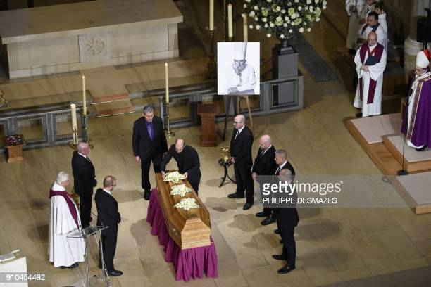 A church official ajusts flowers on the coffin during the funeral ceremony for French chef Paul Bocuse at the SaintJean Cathedral in Lyon on January...