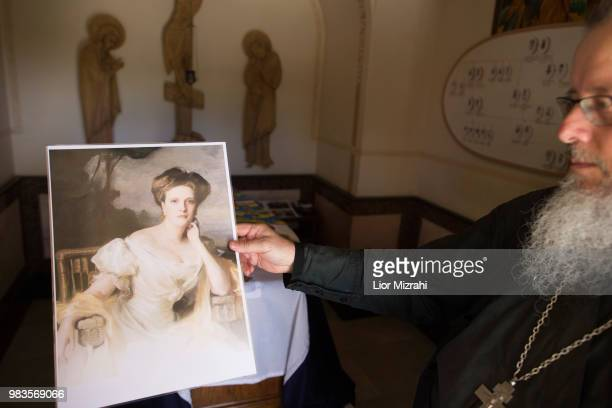 A church official holds a picture of Princess Alice of Battenberg next to her tomb inside the Russian Orthodox church of St Mary Magdalene on the...