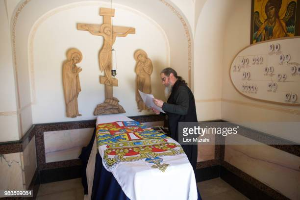 A church official standing next to the tomb of Princess Alice of Battenberg inside the Russian Orthodox church of St Mary Magdalene on the Mount of...