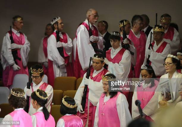 Church officials hold AR15 rifles during a ceremony at the World Peace and Unification Sanctuary on February 28 2018 in Newfoundland Pennsylvania The...