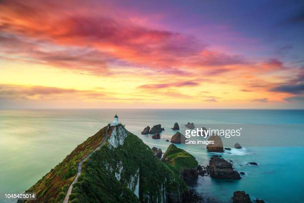 church on cliff at sunset, new zealand - image stock pictures, royalty-free photos & images