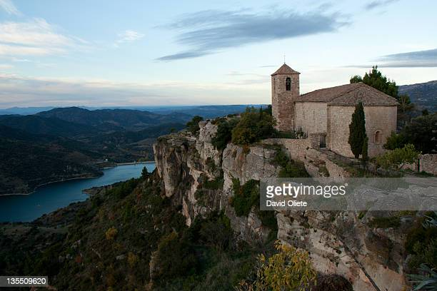church on cliff by river - david oliete stock-fotos und bilder