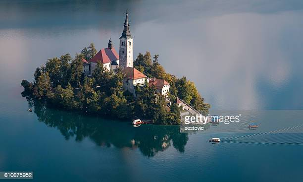 church on island in lake bled, slovenia - slovenia stock pictures, royalty-free photos & images
