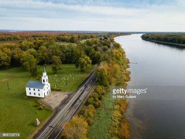 church on the saint john river near maugerville, new brunswick, canada - new brunswick canada stock pictures, royalty-free photos & images