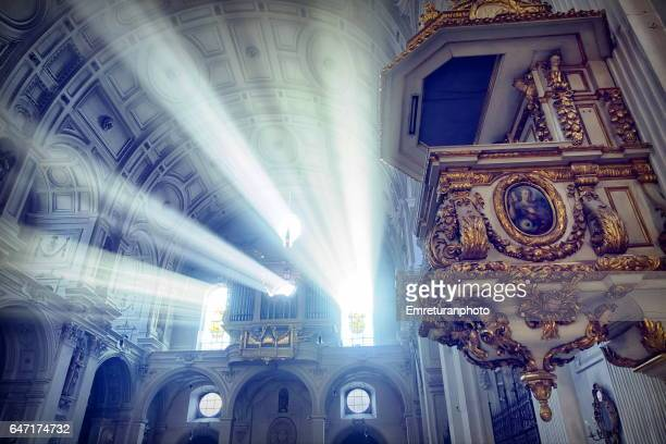 church organ between light beams in st.michael's church,munich. - emreturanphoto stock pictures, royalty-free photos & images