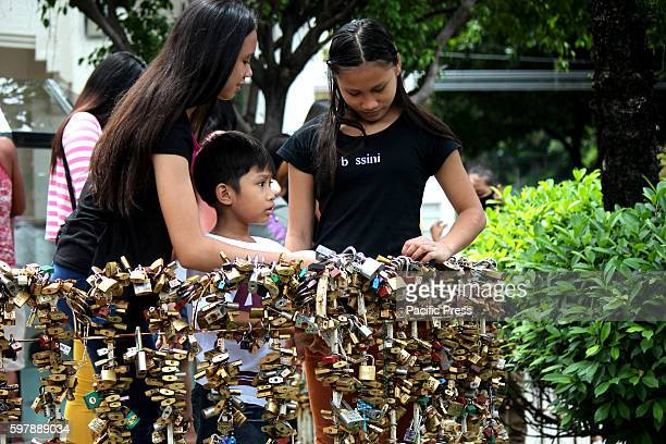 Church parishioners enjoyed to lookin the various Love Locks was tied in fence of Saint Therese inside the compound of Baclaran church in Pasay City...