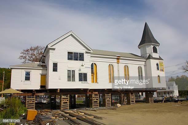 church raised on blocks for redevelopment - methodist church stockfoto's en -beelden
