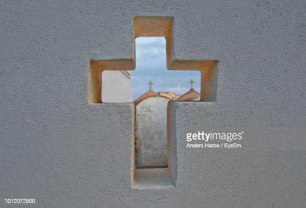 Church Seen Through Cross On Wall