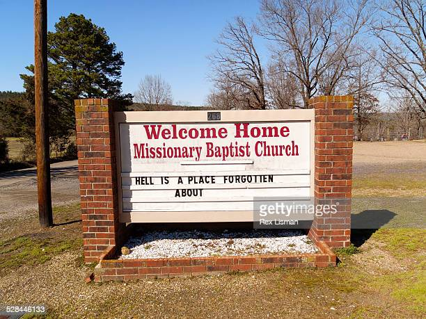 Church sign in front of Welcome Home Missionary Baptist church in rural Arkansas