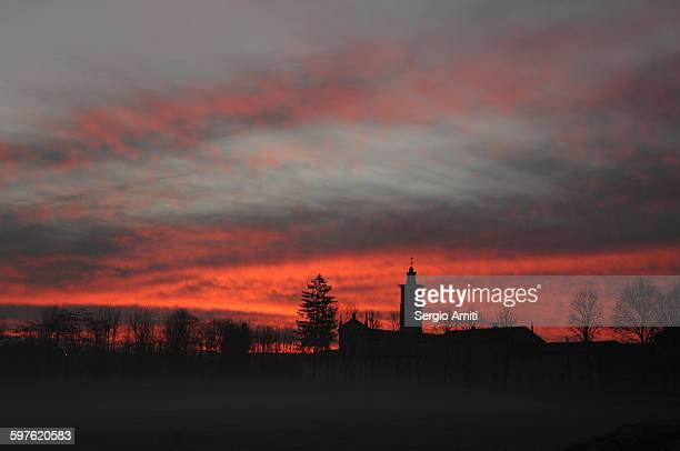 Church silhouetted against the red morning sky