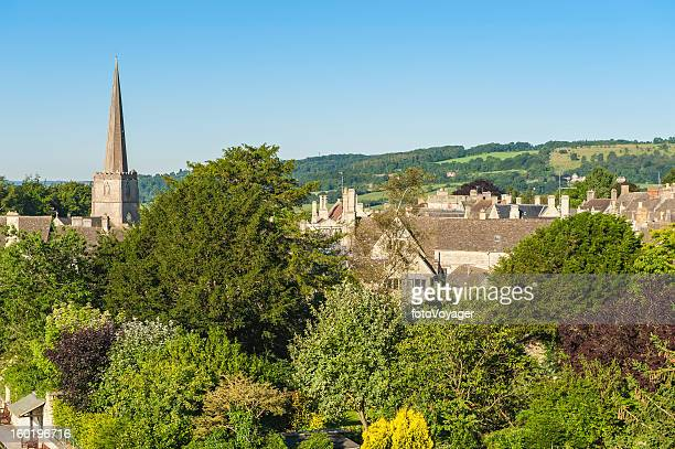church spire and country homes in idyllic summer village - overhemd en stropdas stock pictures, royalty-free photos & images