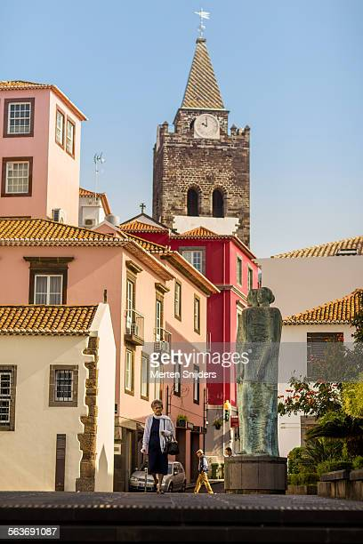 Church spire behind colorful houses on square