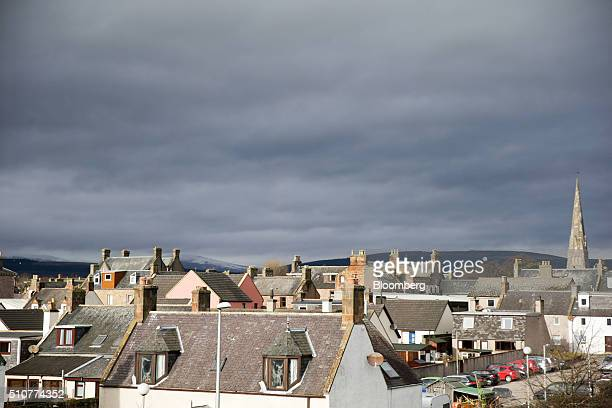 A church spire stands above residential rooftops near the Port of Cromarty Firth in Cromarty UK on Tuesday Feb 16 2016 The pace of drilling in the...