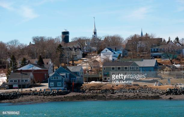 Church spires and a water tank stand atop a the hill on March 3 2017 in Lubec Maine Lubec is the easternmost town in the contiguous United States...
