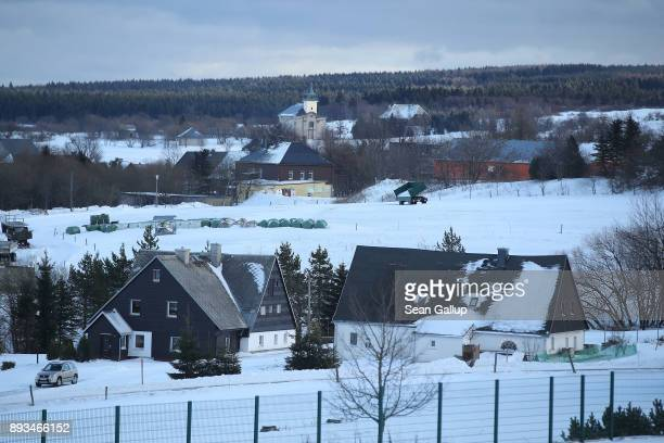 A church stands on a bitter snowswept day on December 14 2017 in the former mining town of Zinnwald near Altenberg Germany Zinnwald will potentially...