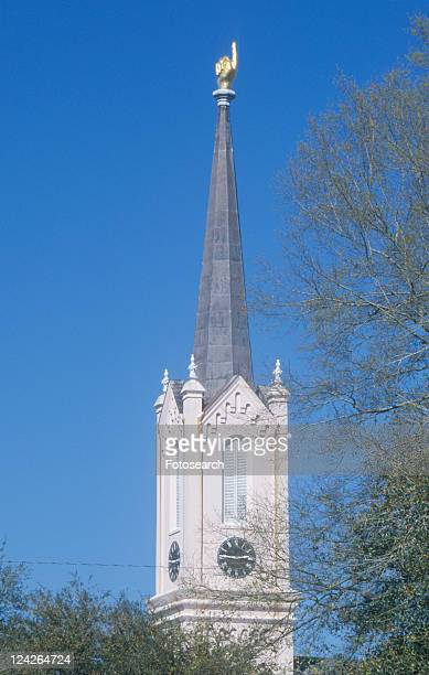 church steeple showing finger pointing upward - presbyterianism stock photos and pictures