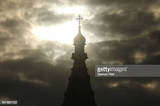 A church steeple stands in the sun by the Moscow River on March 4 2017 in Moscow Russia Relations between the United States and Russia are at their...