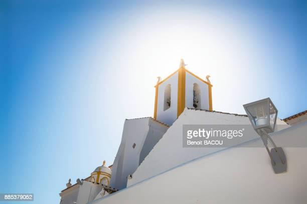 church tower in tavira, algarve region, portugal - tavira imagens e fotografias de stock