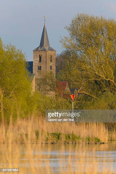 Church tower of the village of Wilsum near the river IJssel