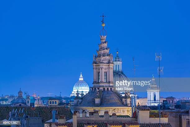 Church towers in blue hour and Basilica di San Pietro in Rome Italy.