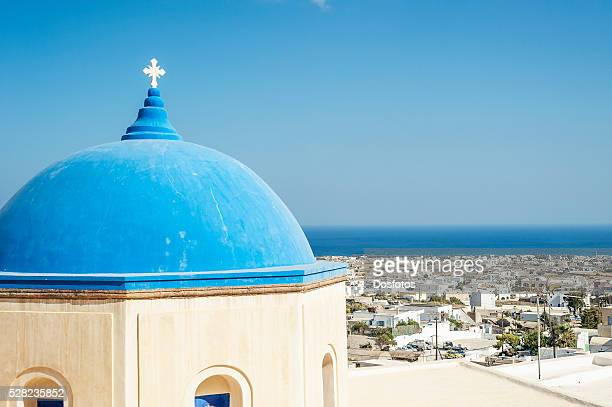 Church with a blue dome roof and view of the Aegean sea; Megalochori, Santorini, Greece