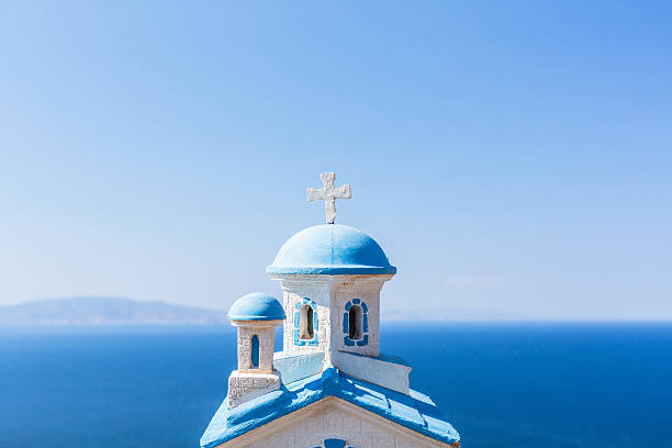 Church with blue dome and sea