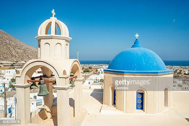 Church with blue dome roof and view of the Aegean sea; Megalochori, Santorini, Greece