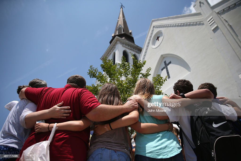 A church youth group from Dothan, Alabama prays in front of the Emanuel AME Church on the one-month anniversary of the mass shooting on July 17, 2015 in Charleston, South Carolina. Visitors from around the nation continue to visit a makeshift shrine in front of the church, in a show of faith and solidarity with 'Mother Emanuel', as the church is known in Charleston. Nine people were allegedly murdered on June 17 by 21-year-old white supremacist Dylann Roof, who was captured by police in North Carolina the following day. He is scheduled to go to trial July 11, 2016.