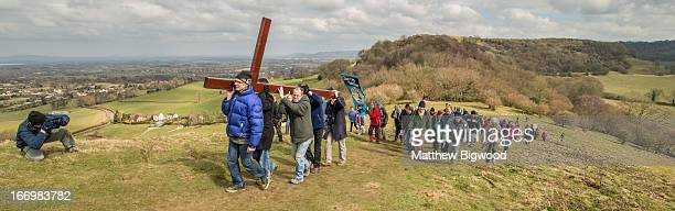 CONTENT] Churches in Cam and Dursley Gloucestershire made their annual journey to the top of Cam Peak on Good Friday to mark Easter by placing a...
