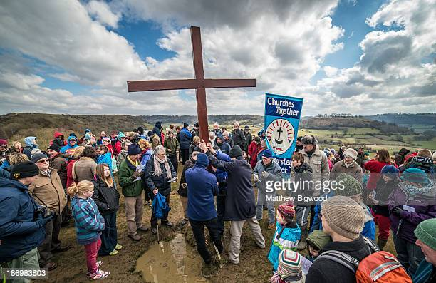 Churches in Cam and Dursley, Gloucestershire, made their annual journey to the top of Cam Peak on Good Friday to mark Easter by placing a wooden...