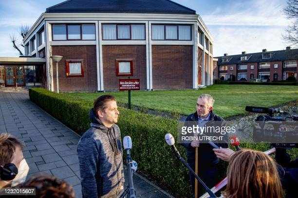 Churchgoer and the auxiliary clerk of the Mieraskerk speak to the press outside the Mieraskerk , after the church was damaged by a small explosion,...