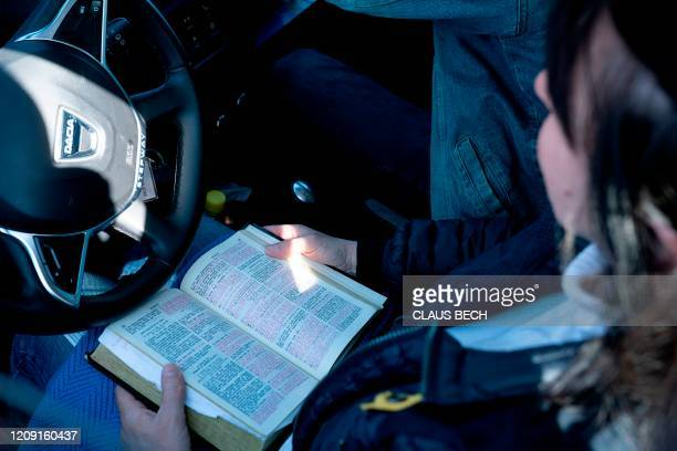 Churchgoer attends a sermon in a car at the Open Church's drive-in service in Copenhagen, Denmark, on the Palm Sunday, on April 5, 2020 amid the...
