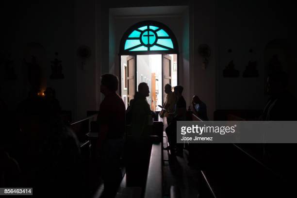 Churchgoers attend a candelit mass at the San Francisco de Asis Church on October 1 2017 in San Juan Puerto Rico Hurricane Maria caused extensive...