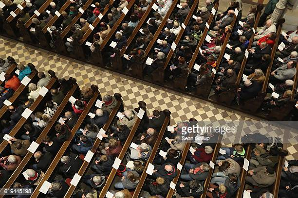 Churchgoers attend a Protestant service at the Schlosskirche church to commemorate the 499th anniversary of theologian Martin Luther's nailing of his...